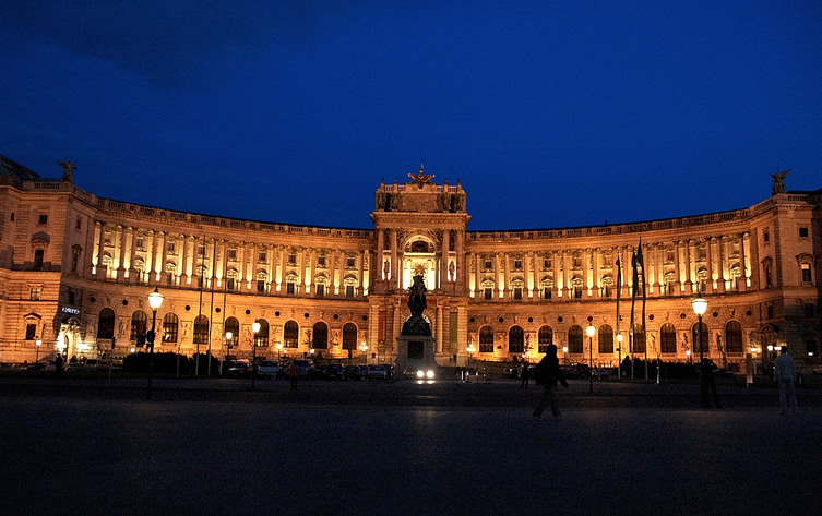A nighttime shot of the front of the Hofburg Palace in Vienna, Austria.