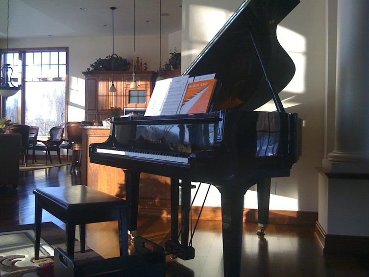 Sun-kissed Yamaha baby grand piano.