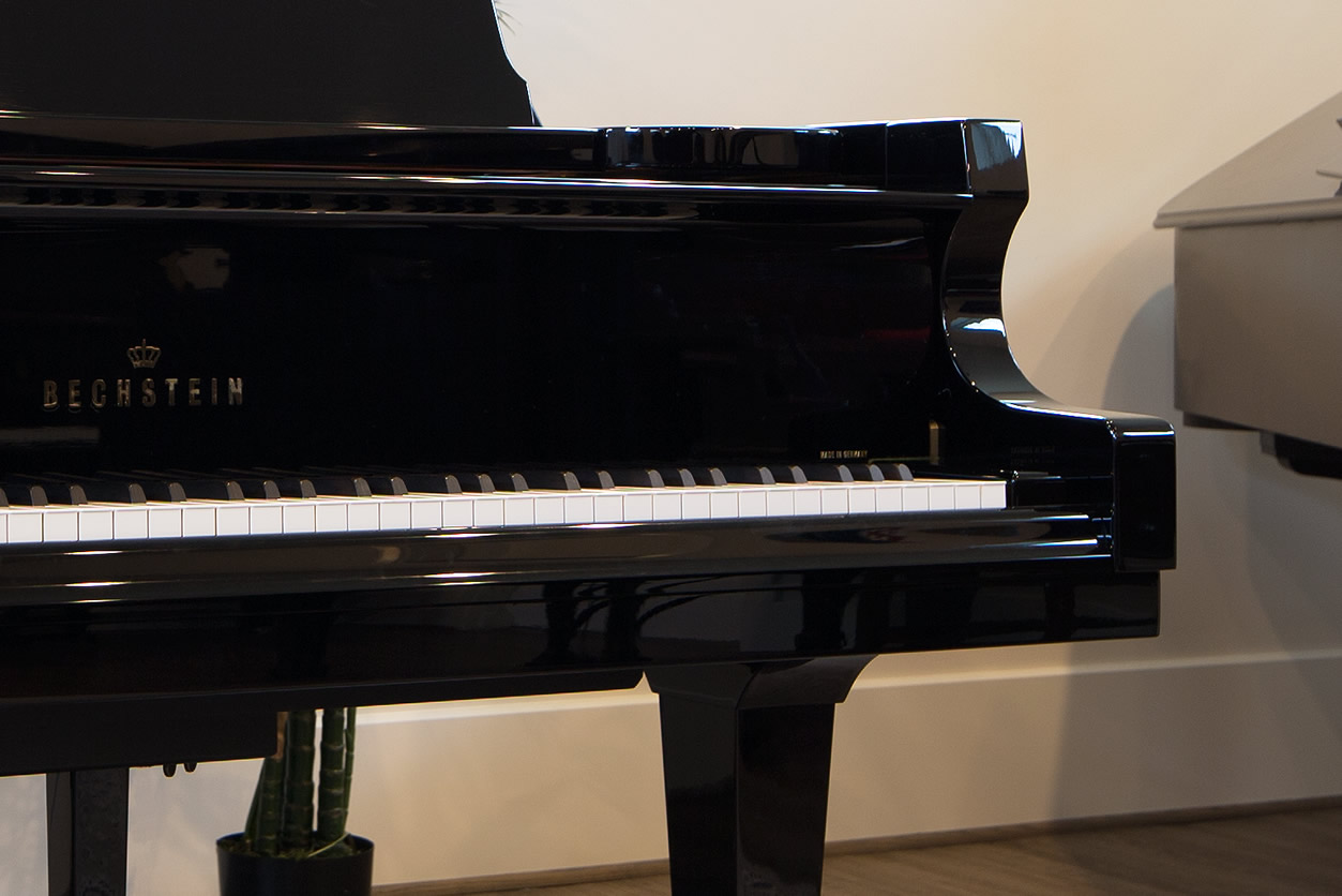 Main Gallery Image: Front, side view of an ebony Bechstein grand piano.