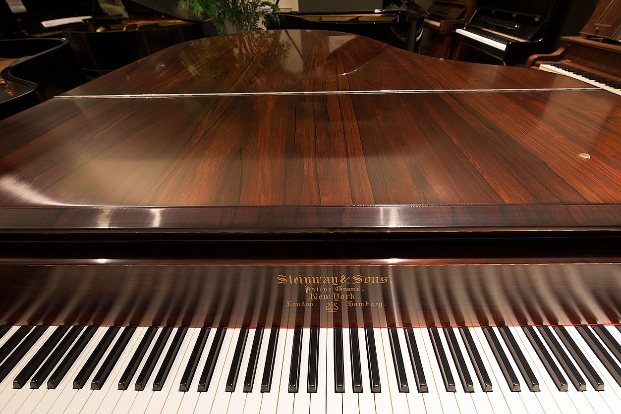"Main Gallery Image: Wide of keyboard, logo, and closed lid for the Steinway & Sons 6' 2"" Brazilian rosewood Art Case parlor grand piano."