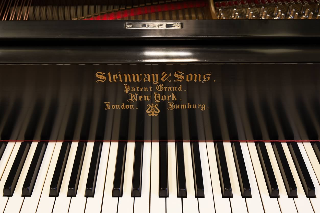 "Main Gallery Image: Close-up of keyboard and logo for the Steinway & Sons ebony, 6' 2"" Art Case A parlor grand piano."