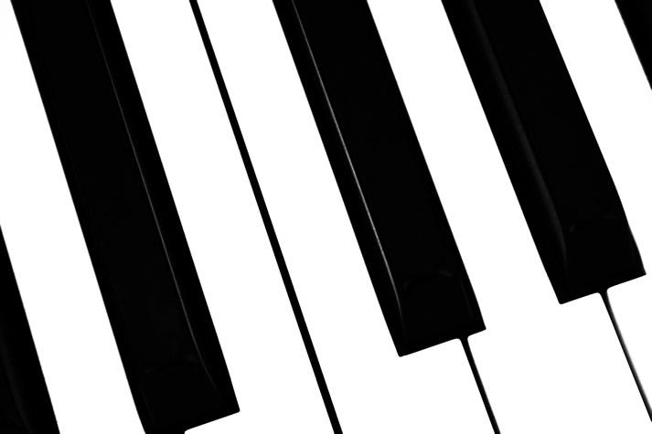 Extreme close-up of piano keys.