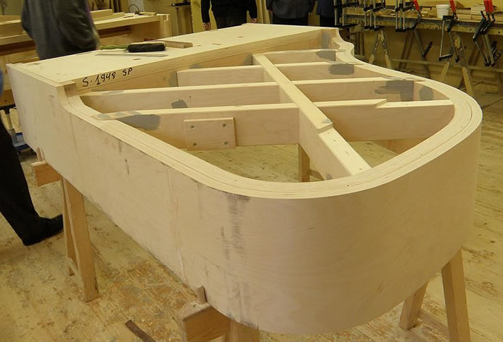 Beginning stages of the frame for an Estonia piano.