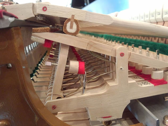 Steinway & Sons grand piano mechanical assembly.