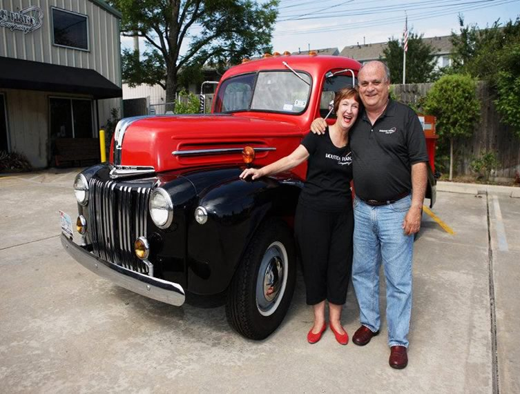 Sue and Steve Merrill posing with the 1942 fully restored Ford pickup truck.