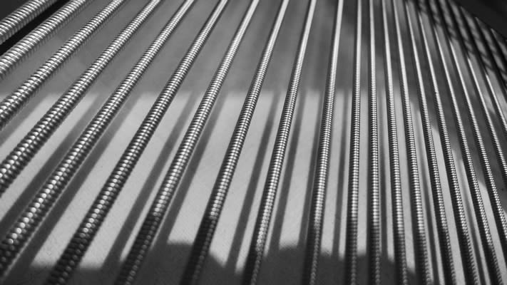 Extreme close-up of the strings on a grand piano.