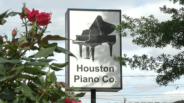 Houston Piano Company's sign located at 1600 W. 13th Street.