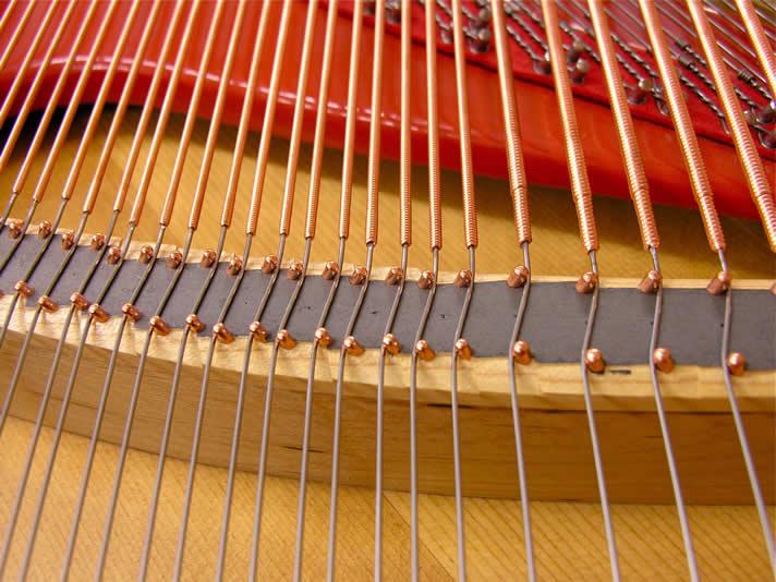 The restoration of a piano bridge.