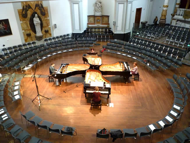 Overhead view of the Dutch Rondone Quartet playing on four Fazioli Grand Pianos.