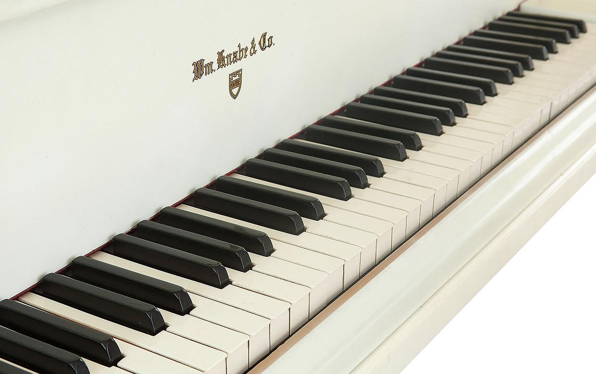 Side angle of Elvis Presley's white Knabe grand piano.