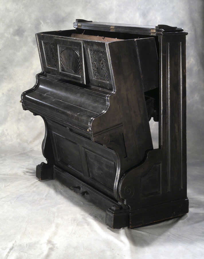 Convertible bed that looks like an upright piano by Smith & Co., c. 1885.