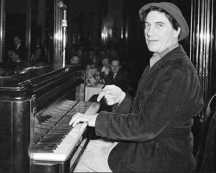 Chico Marx playing the piano, photographed by Allison-Lighthall, c. 1956.