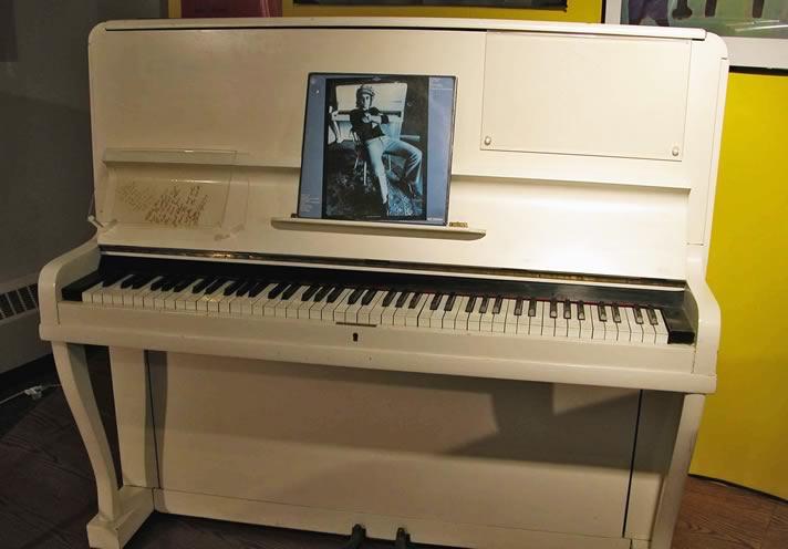 Elton John's upright piano, c. 1910.