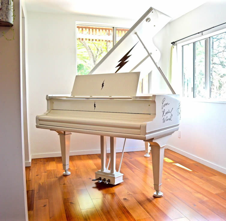 Linda Perry's 1929 white Mason & Hamlin baby grand piano with celebrity signatures.