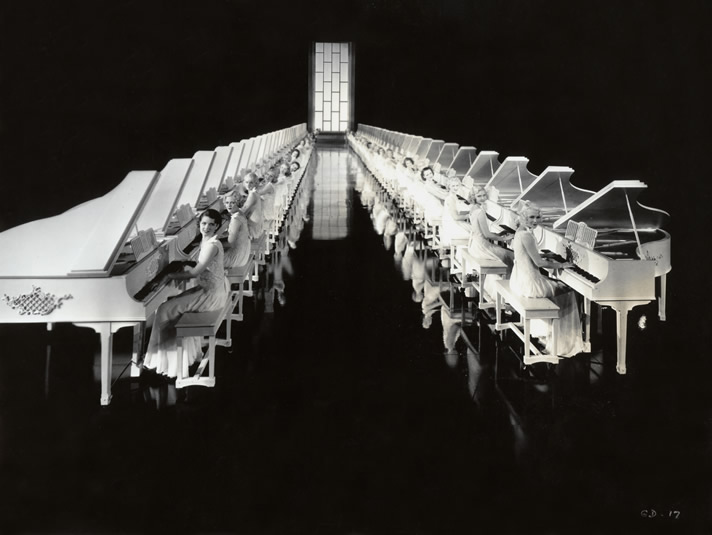 Corridor of white grand pianos from Busby Berkeley's 'Gold Diggers of 1935'.