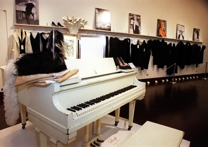 Marilyn Monroe's white piano showcased at the auction of her estate.