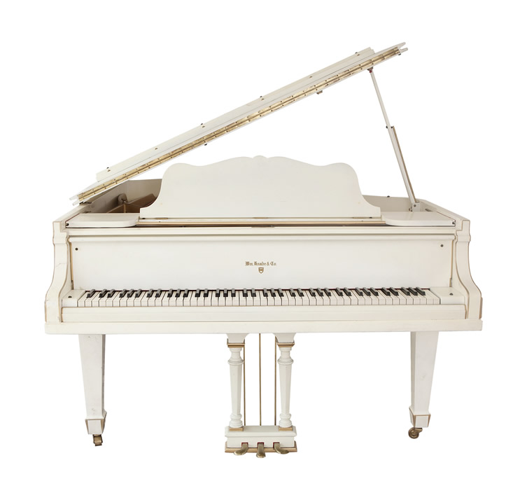 Full view of Elvis Presley's white Knabe grand piano.