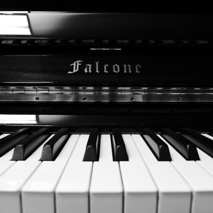 Close-up of a Falcone vertical piano.