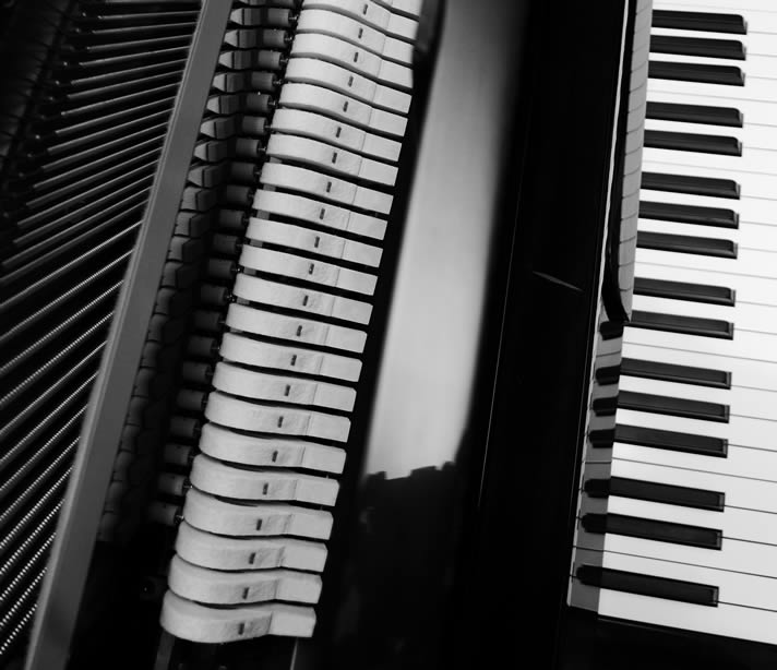 Overhead view of the keyboard and interior of a Falcone upright piano.