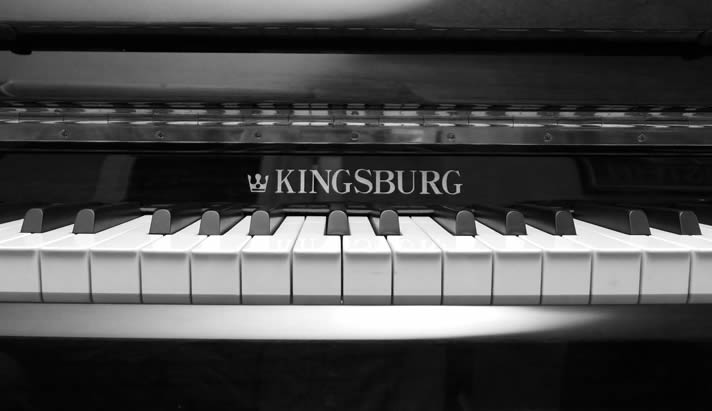 Detail of a Kingsburg upright piano.