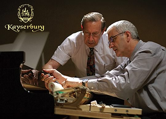 Lothar Thomma and his Protégé Stephen Mohler overseeing a Kayserburg piano, part of the Pearl River family.