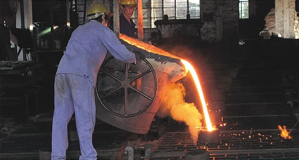 Molten iron being poured at the Pearl River foundry.