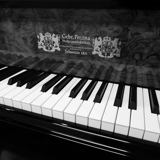 Close-up of the logo and keyboard of a Perzina grand piano.