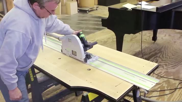 Installer cuts the keyframe, keybed and prepares the rail slot for PianoDisc installation.