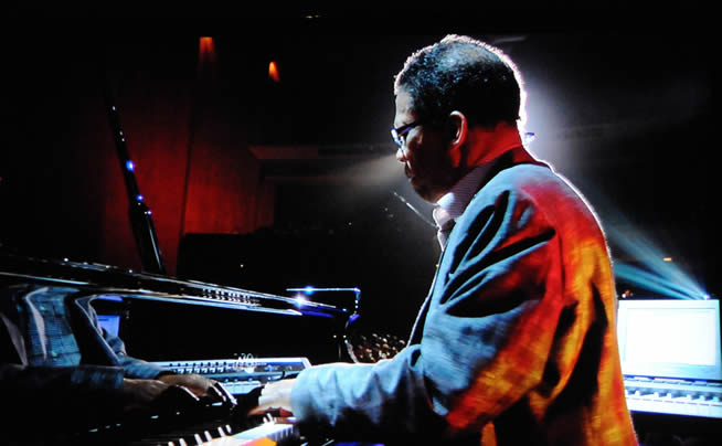 Herbie Hancock playing the piano, photographed by Larry Johnson, in 2009.