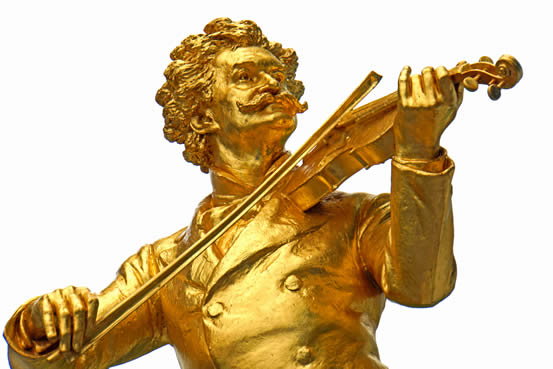 Gold statue of Johann Strauss II, photographed by Dennis Jarvis.