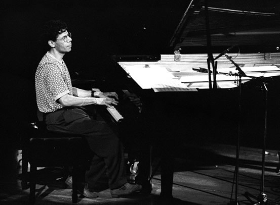Chick Corea playing the piano in Normandy, France, 1992, photographed by Roland Godefroy.