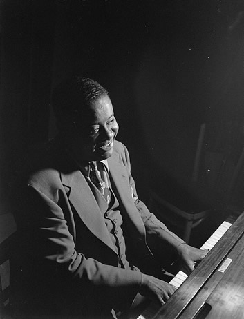 Art Tatum playing the piano c. 1946, photographed by William P. Gottlieb.