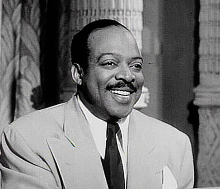 Still image of Count Basie from the film 'Rhythm and Blues Revue' in 1955.
