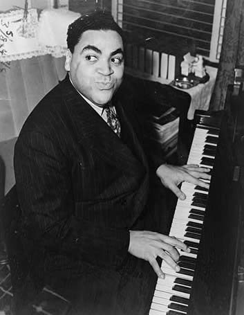 Fats Waller playing the piano in 1938, photographed by Alan Fisher.