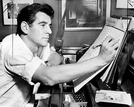 Leonard Bernstein making annotations to a musical score in 1955, photographed by Al Ravenna.