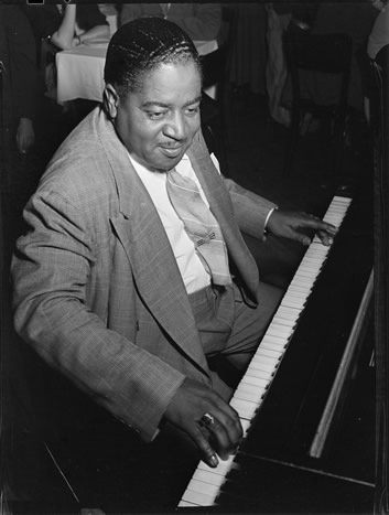 Pete Johnson playing the piano c. 1946, photographed by William P. Gottlieb.